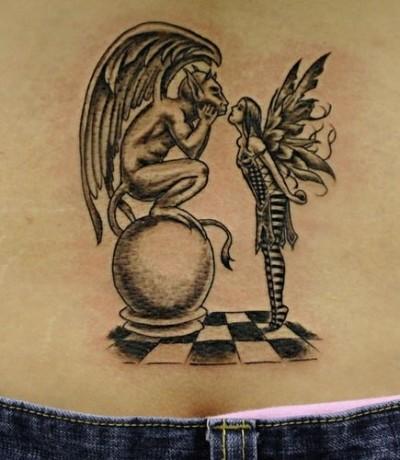 Татуировка на пояснице фея и статуя